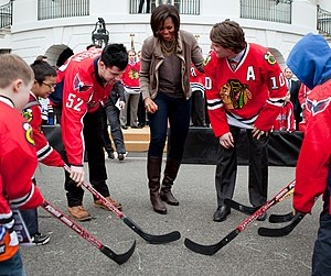 Let's Move! - First Lady Michelle Obama participates in a Let's Move! and NHL partnership event in March 2011 alongside Mike Green (left) and Patrick Sharp (right).
