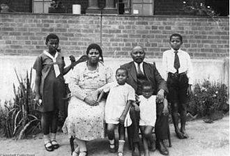 John Langalibalele Dube - Mid 1930s John and his second wife Angelina Dube with (l to r) Nomagugu, Joan Lulu, James Sipho and Douglas Sobanto.