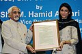 Mohd. Hamid Ansari presenting the National Amity Award to the Legendary actor and Parliamentarian Sunil Dutt (Posthumously), the award being received by his daughter Ms. Priya Dutt (Member of Parliament, Lok Sabha).jpg