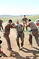 Mongolian service members run through a pepper spray qualification course during Non-Lethal Weapons Executive Seminar (NOLES) 13 at Five Hills Training Area, Mongolia, Aug. 21, 2013 130821-M-DR618-150.jpg
