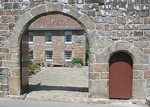 Saint Lawrence, Jersey - The arched entrance to Morel Farm, a National Trust for Jersey property in St. Lawrence, bears the date inscription 1666. Along with Hamptonne and Le Rât cottage, it is one of the notable examples of rural architecture in the parish