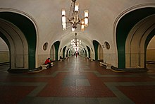 Wide, round-ceilinged hallway of VDNKh Metro station