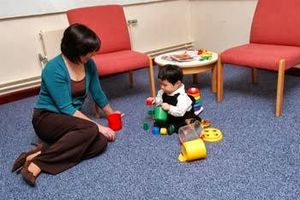 Early childhood education - A child exploring comfortably due to having a secure attachment with caregiver.