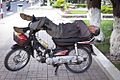 Motorcycle sleep guy 2012 (6806905451).jpg