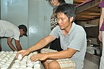 Mr. Thien inspects egg at his duck hatchery in Can Tho (14219978446).jpg