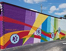 Mural by Shannon Willow in East Atlanta featuring dog paws