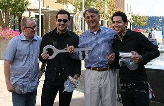 MxPx - L to R: Yuri Riley, Tom Wisniewski, Mayor Cary Bozeman, Mike Herrera (the band receiving the Key to Bremerton in 2006)