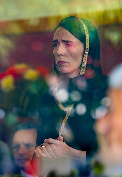 "Ardern visits members of the Muslim community at the Phillipstown Community Centre, 16 March 2019. Captured through a glass window, the photo was widely shared at the time and described by The Guardian as ""an image of hope"". NZ PM Jacinda Ardern - Kirk HargreavesCCC.jpg"
