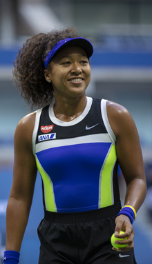 Naomi Osaka smiling during her match against Azarenka in the 2020 US Open.