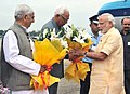 Narendra Modi being welcomed by the Governor of Jammu and Kashmir, Shri N.N. Vohra and the Chief Minister of Jammu and Kashmir, Shri Mufti Mohammad Sayeed, on his arrival, at Jammu Airport, in Jammu and Kashmir.jpg