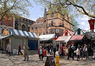 Norwich Market With St Peter Mancroft church and the Sir Garnet public house in the background. Norwich Market - geograph.org.uk - 827962.jpg