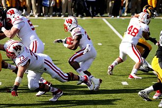 James White (running back) - White running the ball against Iowa, a Badgers rival, in November 2013.