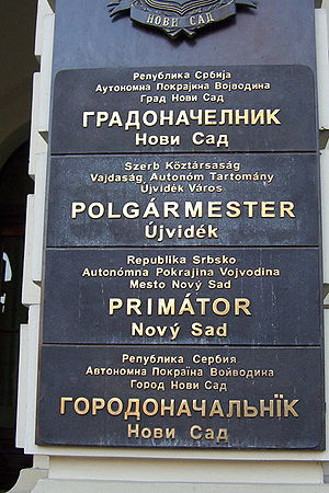 Multilingualism - Multilingual sign outside the mayor's office in Novi Sad, written in the four official languages of the city: Serbian, Hungarian, Slovak, and Pannonian Rusyn