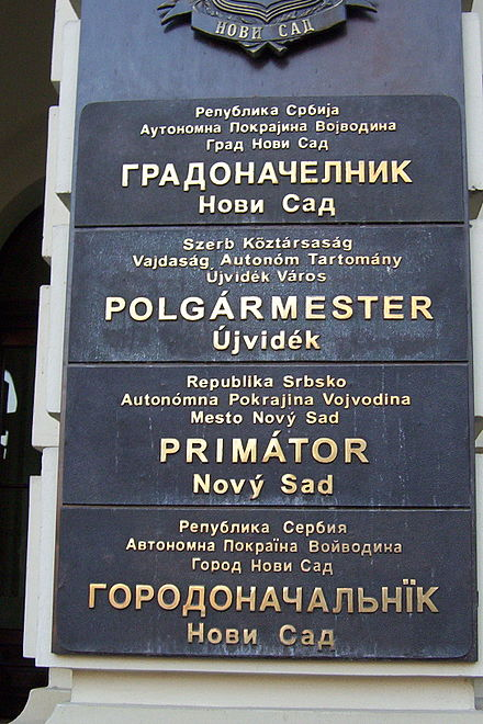 Multilingual sign outside the mayor's office in Novi Sad, written in the four official languages of the city: Serbian, Hungarian, Slovak, and Pannonian Rusyn. Novi Sad mayor office.jpg
