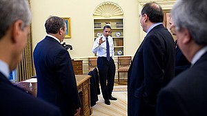 English: President Obama confers with senior a...