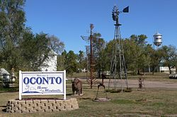 Oconto welcome sign, windmill, and sculptures