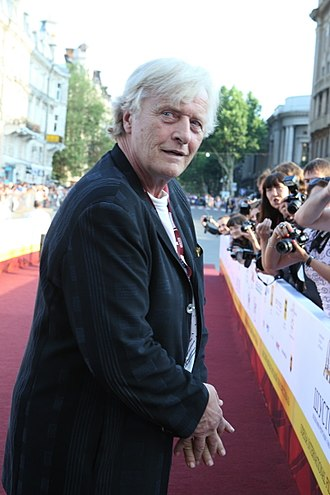On a Night Like This - Minogue played Rutger Hauer's (pictured) mistress in the music video.