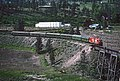 Okanagan Express CP 8836 and 8839 approaching Trout Creek Bridge at West Summerland, BC on May 23, 1983 (34809973563).jpg
