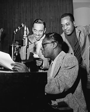 Oscar Moore - Oscar Moore with Nat King Cole and Wesley Prince, c. June 1946 Photo: William P. Gottlieb