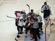 Referees attempt to break up a fight around the Tampa Bay goal during the first ice hockey playoff game between the Ottawa Senators and the Tampa Bay Lightning for the 2006 Stanley Cup.