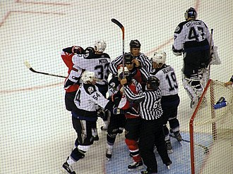 Violence in ice hockey - Linesmen attempt to break up a fight around the Tampa Bay goal during the first ice hockey playoff game between the Ottawa Senators and the Tampa Bay Lightning.