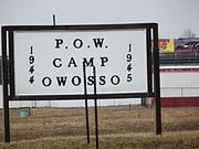 Owasso, MI POW camp sign