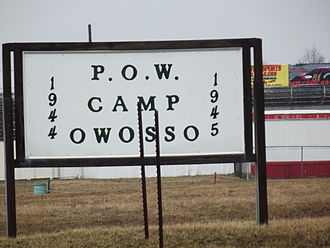 German prisoners of war in the United States - A current (2013) sign outside the Owosso, MI, WW-II P.O.W. camp where German soldiers were held. The site had been, and then was again, the Owosso racetrack.