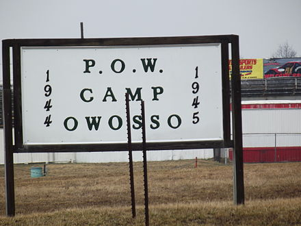 A current (2013) sign outside the Owosso, Michigan, WWII P.O.W. camp where German soldiers were held. The site had been and is currently the Owosso racetrack. Owasso, MI POW camp sign.jpg