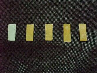 Emulsion dispersion - Pristine nylon-6 (white) and nylon-6/LNR blends (yellow) films, prepared via emulsion dispersion technique.