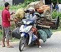 Pair with Loaded Bike - Dien Bien Phu - Vietnam (48178461876).jpg