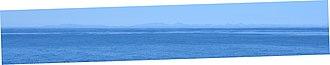 Chukchi Peninsula - Panorama of the mountains in Chukotka, Russia, as seen from Gambell, Alaska