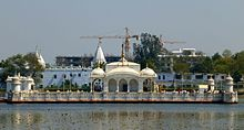 Large, white temple on the water