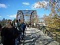 People walking across War Eagle Bridge.jpg