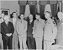 Photograph of President Truman in the Oval Office after presenting three Korean War veterans with the Medal of Honor... - NARA - 200295.jpg