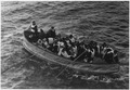 Photograph of a lifeboat carrying TITANIC survivors. The following partial caption appears on the back of the... - NARA - 278338.tif
