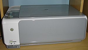 Multi-function printer - A Hewlett-Packard Photosmart C3180, featuring card readers and photo printing.  An example of an AIO.