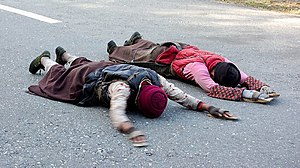Pilgrimage - Tibetans on a pilgrimage to Lhasa, doing full-body prostrations, often for the entire length of the journey