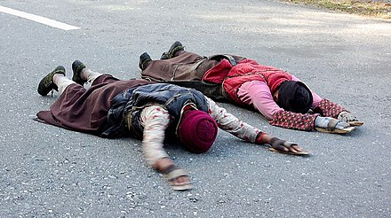 Tibetans on a pilgrimage to Lhasa, doing full-body prostrations, often for the entire length of the journey Pilgrimage to Lhasa.jpg