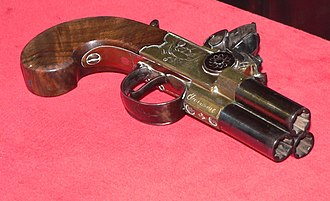Volley gun - Three-barrel tap-action pocket pistol capable of firing all barrels simultaneously or sequentially using a rotating block in the pan.