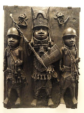 Peabody Museum of Archaeology and Ethnology - Bronze plaque depicting chief flanked by two warriors, Benin Empire, AD 1550-1650. African collection, Peabody Museum