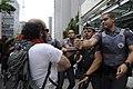 Police officer assaulting protester trying to rescue Caio Castor, São Paulo, 2015.jpg