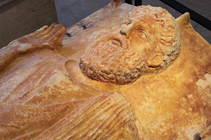 Ancient Carthage - Sarcophagus of a priest, showing a bearded man with his hand raised; ancient Carthaginian funerary art now located in the Louvre, Paris