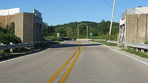 Illinois Route 155 - Heading north through a gate in the Prairie du Rocher floodwall