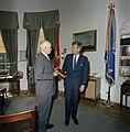 President John F. Kennedy Receives Book from General Omar N. Bradley (02).jpg