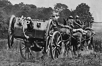 I Parachute Battery (Bull's Troop) Royal Horse Artillery - Photo showing 13 pounder gun team galloping into action.
