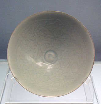 "Jingdezhen porcelain - Qingbai (""Blueish-white"") glazed bowl with carved peony designs, Jingdezhen, Southern Song, 1127–1279."