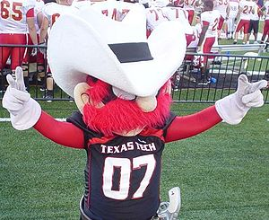 "Guns Up - Raider Red showing the ""Guns up"" hand sign"