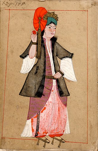 Ottoman clothing - A stylish young woman of the mid-17th century. She wears şalvar (trousers), a long, sheer gömlek (chemise), and an ankle-length purple entari (outer robe) with the ends tucked up. The fur lining of her yelek (jacket or vest) marks her as wealthy and high-ranking.