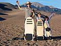 Ranger Patrick and Kids with Two Sand Sleds and a Sandboard (8622993390).jpg
