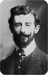 Head of a young man with moustache and beard and a full head of hair